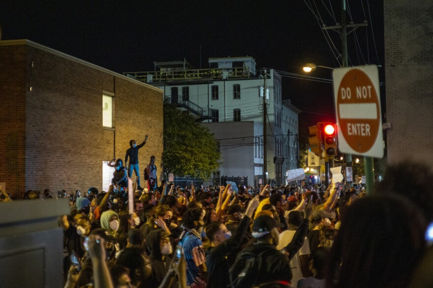 Protesters gather in Richmond, Va., on Saturday night.