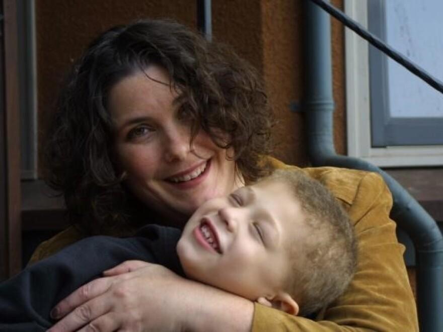 Jane Kemp and her son, Kieran, celebrate their first Hanukkah together.