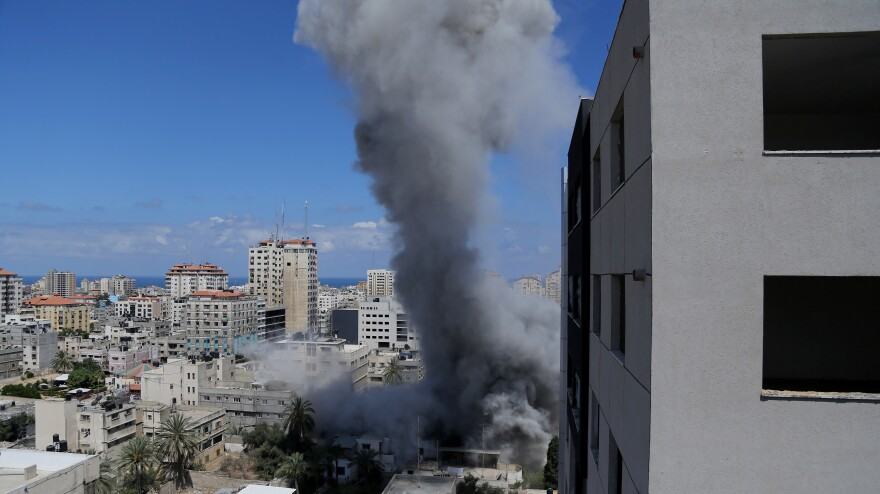 Smoke rises after an Israeli missile strike in Gaza City on Friday.