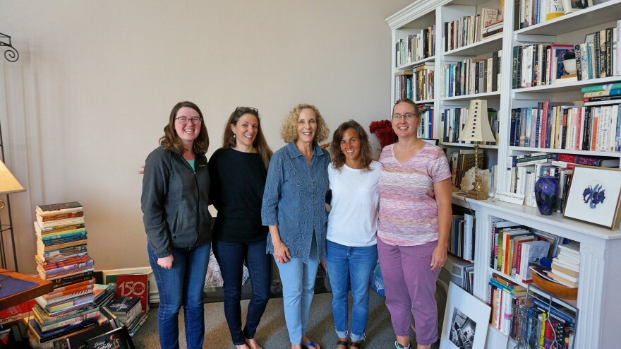 The Orange Frazer team includes, from left, Designer Kelly Schutte, Project Developer Margaret Morgan, Publisher Marcy Hawley, Project Manager Sarah Hawley, and Office Manager Janice Ellis. Not pictured is Editor John Baskin.