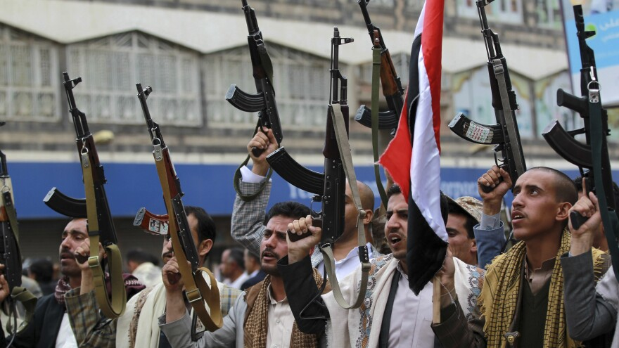 Shiite Houthi rebels hold up their weapons in a protest Thursday against Saudi Arabian airstrikes in Yemen's capital Sanaa. Saudi Arabia bombed military installations as the rebels, aligned with Iran, pressed ahead with their advance.