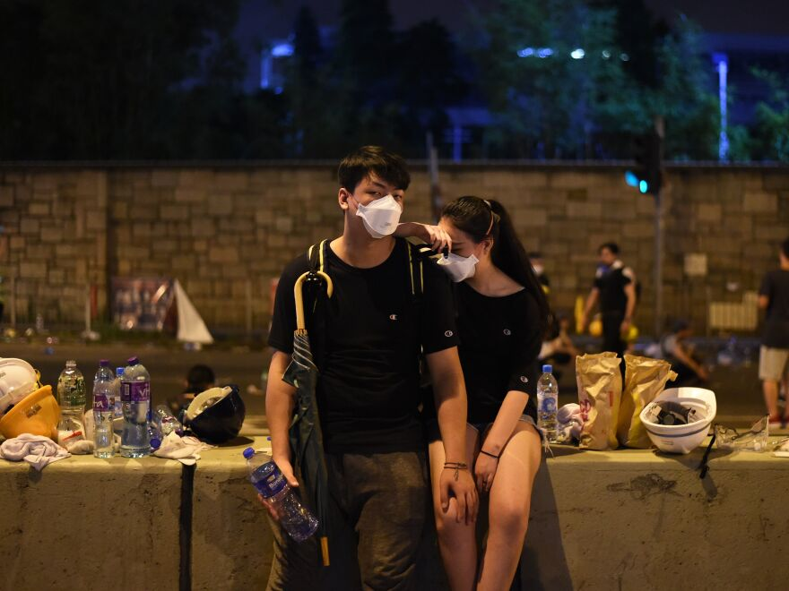 Demonstrators rest the night after protests against Hong Kong's controversial proposed extradition law late Wednesday.