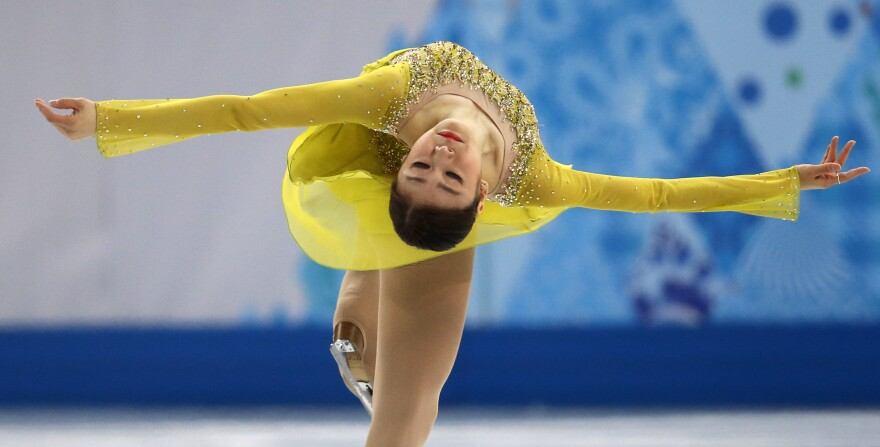 Yuna Kim, of South Korea, won gold in Vancouver. She's leading the field after Wednesday's short program.