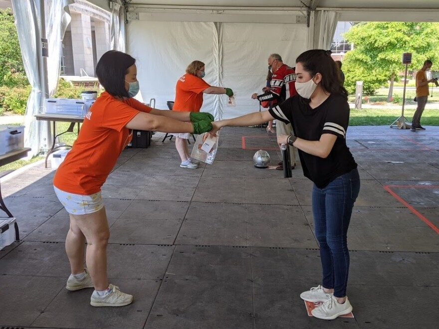 University of Illinois graduate student Kristen Muñoz submits her saliva sample for coronavirus testing on the Urbana-Champaign campus.