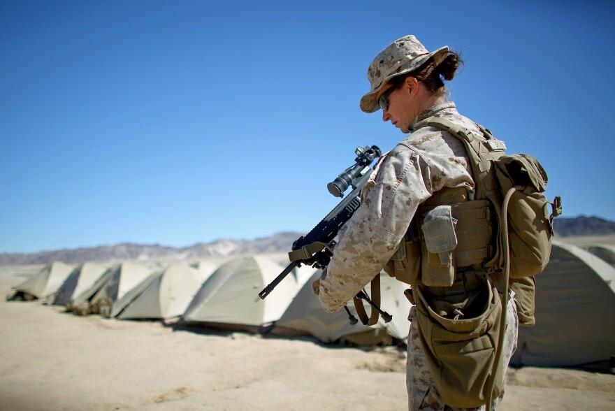 Sgt. Kelly Brown puts her weapon over her shoulder at the Marine base at Twentynine Palms, Calif.
