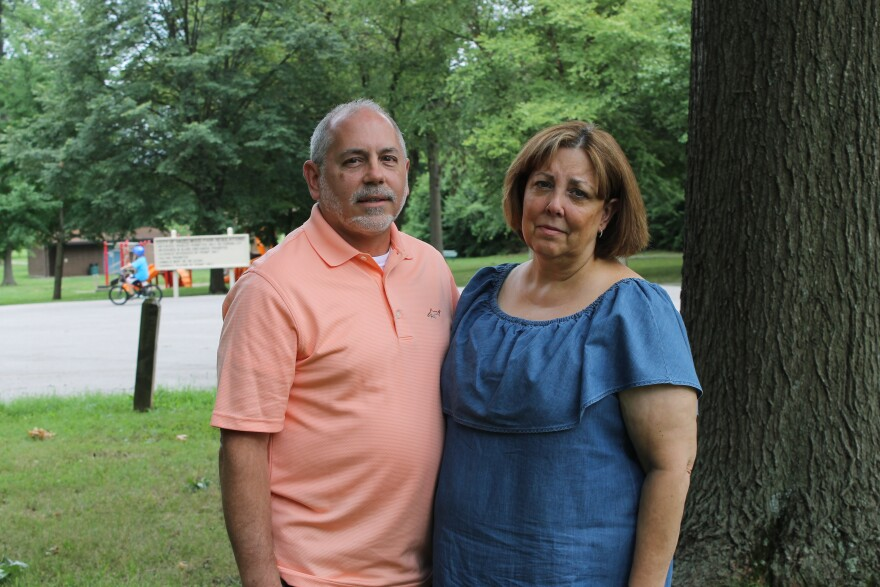 Gerard and Mary Oscko stand in front of their home in Hazelwood. Coldwater Creek, which has been linked to increased cancer risk, is in the background.