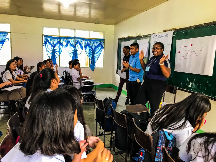 Peace Corps volunteers Aris Hines (left), Angelo Baldado, and Emily Mallobe lead a session with students in the Philippines on how to set — and achieve — goals.
