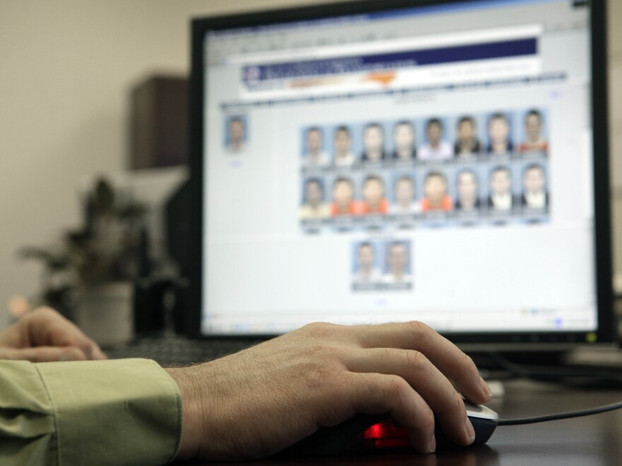 Stephen Lamm, supervisor with the ID Fraud Unit of the North Carolina DMV, looked through photos in the facial recognition system. Authorities also have access to many photos on social media.