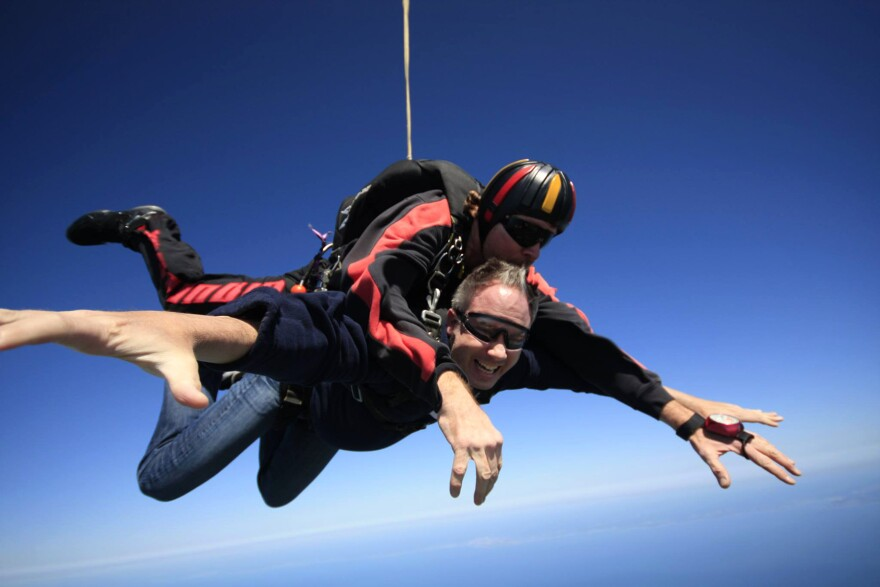 Bret Parker went skydiving in 2013 to raise money for the Michael J. Fox Foundation. Parker participated in a study earlier this year about whether a wearable tracker could effectively measure the severity of tremors caused by Parkinson's.