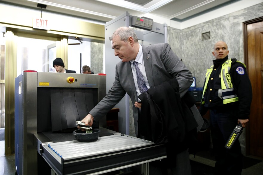 Lev Parnas, a former Rudy Giuliani associate with ties to Ukraine, collects his belongings after going through a security checkpoint during the impeachment trial of President Trump on Wednesday.