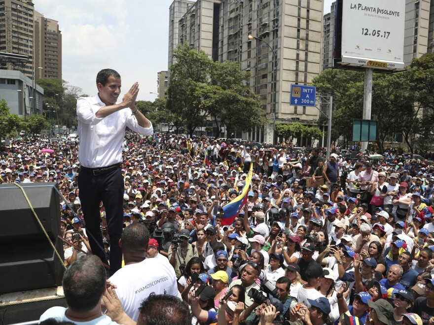 Opposition leader Juan Guaidó shows gratitude to supporters during a rally in Caracas, Venezuela, on Wednesday. Guaidó called for Venezuelans to fill streets around the country Wednesday to demand President Nicolas Maduro's ouster.