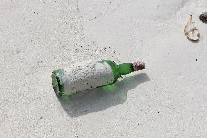 wine_bottle_on_beach.jpg