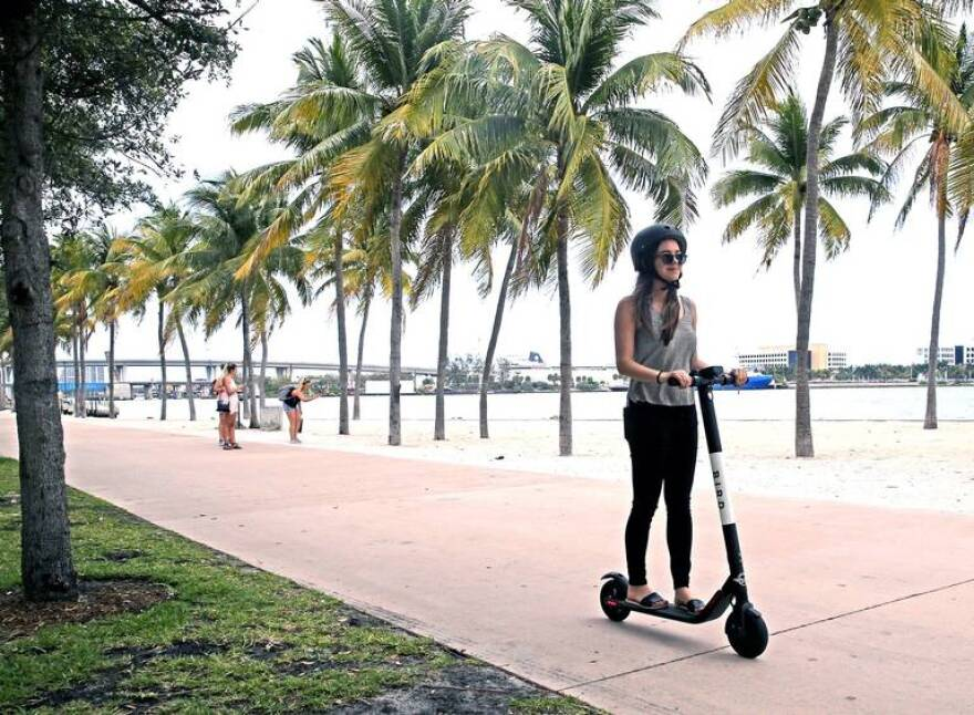Tori Petersen rides an electric scooter in Bayfront Park, April 2, 2019.