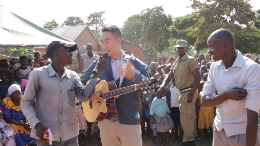 Washington University medical student Jae Lee speaks at the opening of the Empower Through Health clinic in Mpunde, Uganda