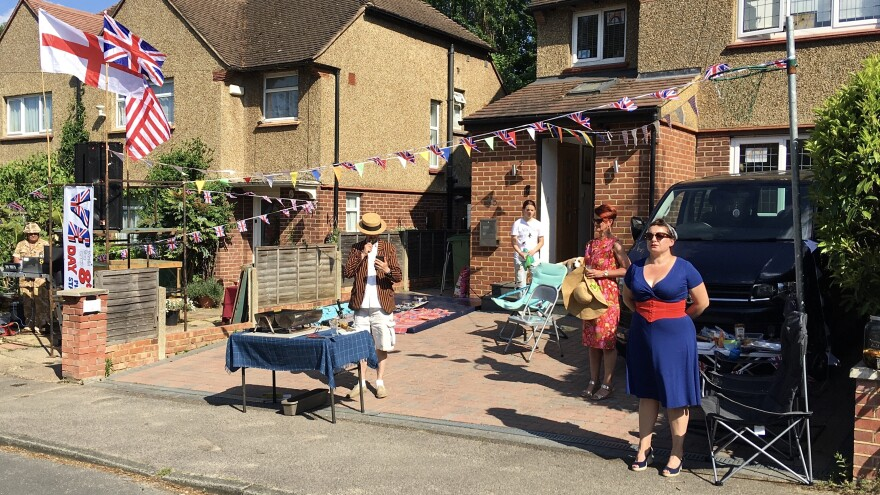 Neighbors in the town of Weybridge outside of London blasted World War II-era tunes and some dressed in 1940s clothing as they held a socially distanced block party to celebrate V-E Day.