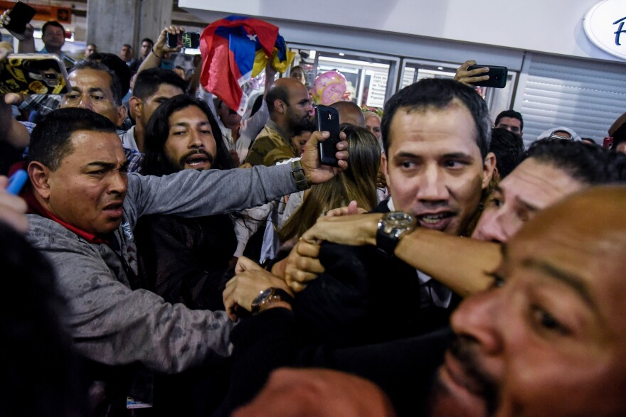 Opposition leader Juan Guaidó at Maiquetía Airport in February in Caracas. Guaidó returned to Venezuela after traveling to Colombia, Europe, Canada and the United States to try to gain support for his effort to oust President Nicolás Maduro. By year's end, Maduro remained in power and Venezuela near collapse.