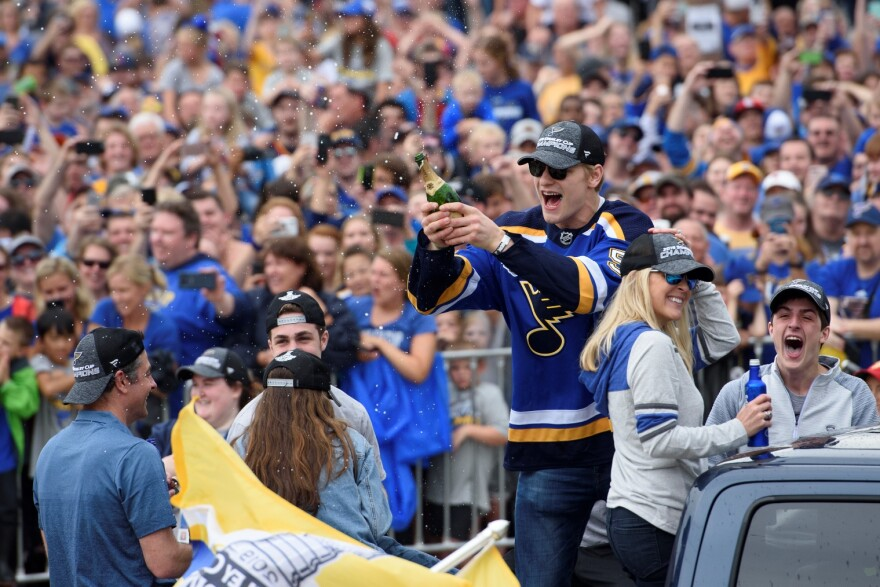 Blues defenseman Colton Parayko sprays champagne in celebration during the Blues championship parade. June 15, 2019