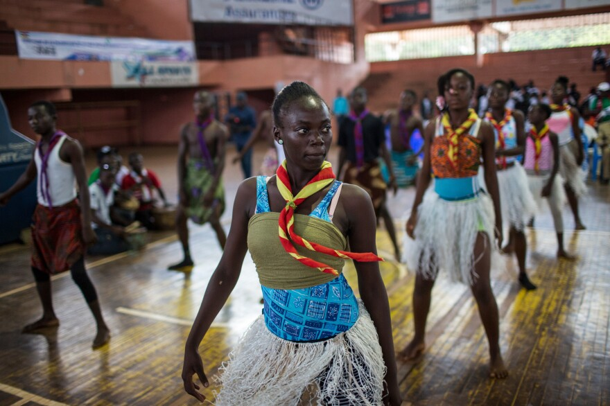 The scouting groups in the Central African Republic are now working to recruit female members. Above: Scouts perform a dance routine during a youth event in Bangui.
