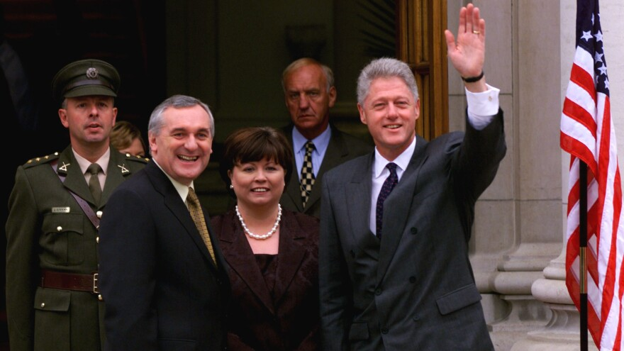 President Bill Clinton during his 1998 visit to Ireland with Irish Prime Minister Bertie Ahern and Deputy Prime Minister Mary Harney — a trip overshadowed by impeachment hearings.