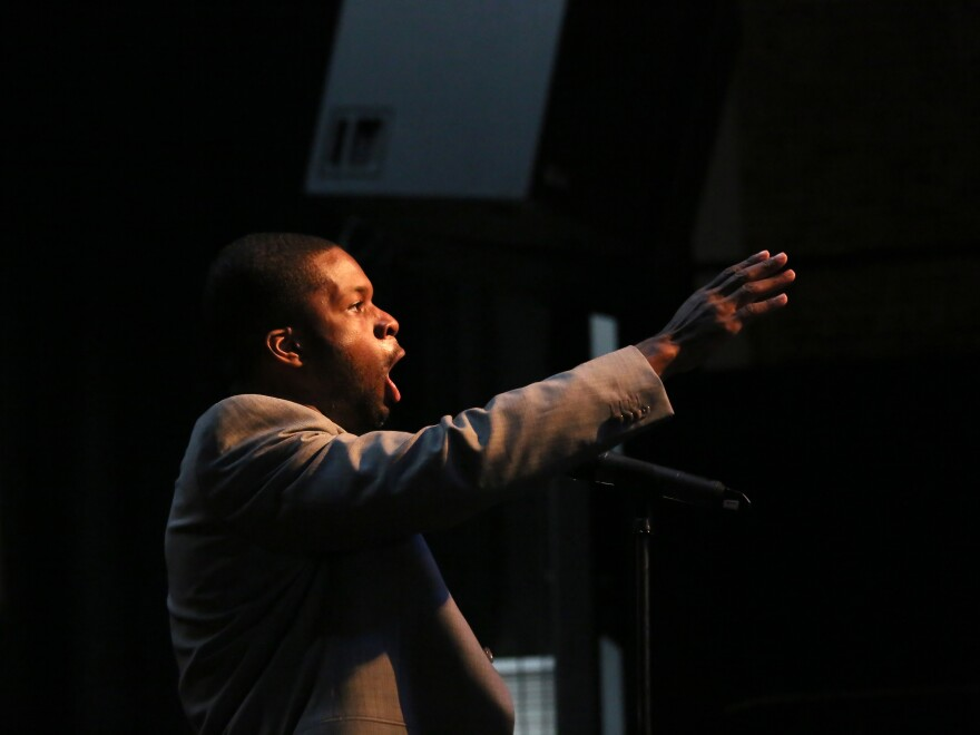 Justin Hopkins sings during a tribute show for Booker Wright, who worked in a whites-only restaurant in the Mississippi Delta.