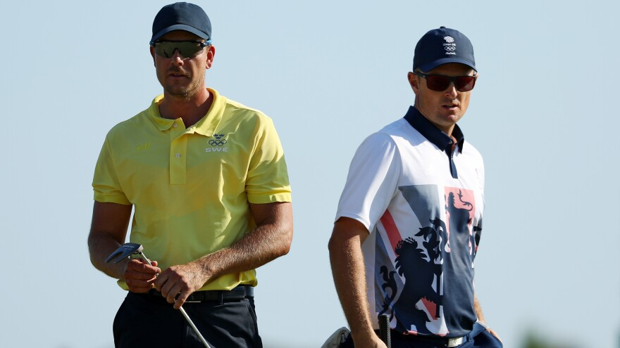Justin Rose of Great Britain (right) edged Henrik Stenson of Sweden on the 18th hole to win a gold medal in Olympic golf Sunday. The match was played at the Olympic Golf Course in Rio de Janeiro.