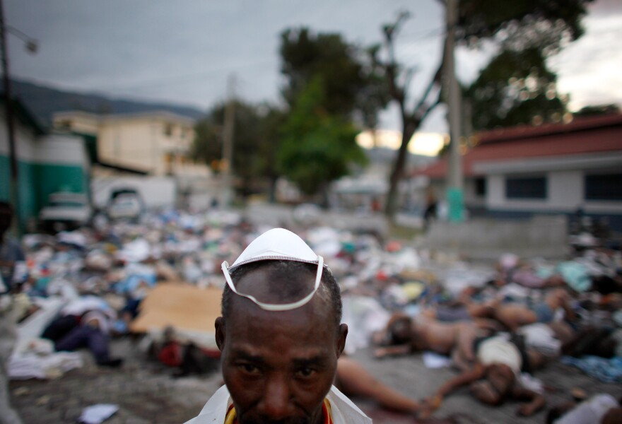 Just two days after the quake hit, morgue workers struggle to deal with the thousands of bodies that have piled up at the central morgue at the hospital in downtown Port-au-Prince.