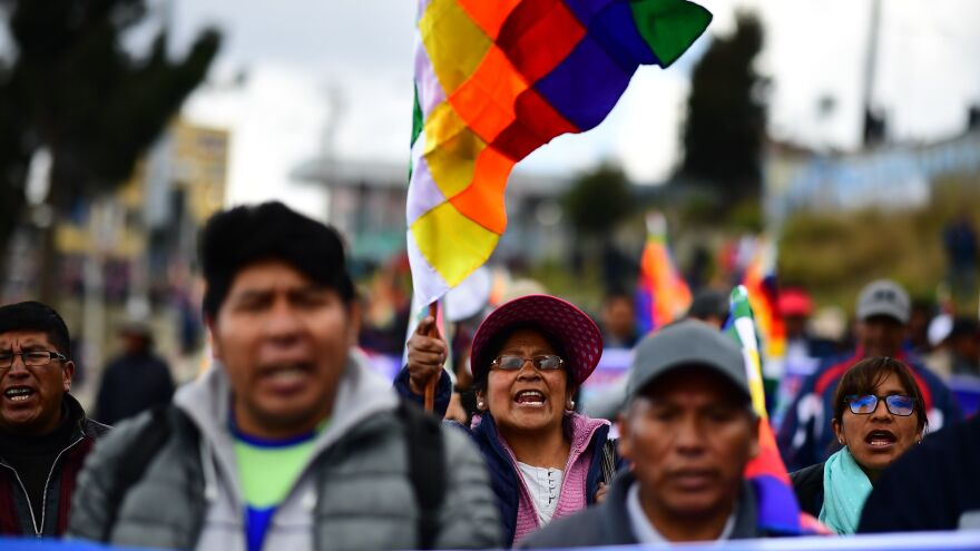"""Supporters of Evo Morales, who recently resigned as president of Bolivia, take part in a protest march Wednesday from El Alto to La Paz. Morales has condemned Áñez, who declared herself interim president, as the perpetrator of a """"sneaky coup."""""""