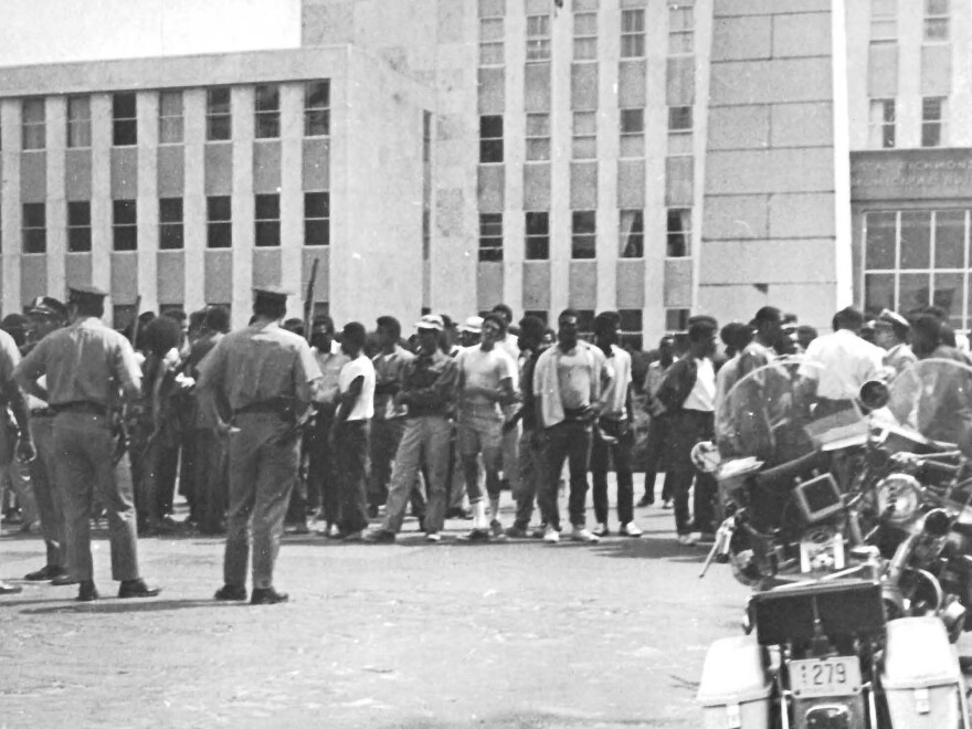 Protestors held a rally at a municipal building prior to the riot in Augusta, Ga., in 1970. Approximately 300 people attended and 25–30 police officers stood watch.