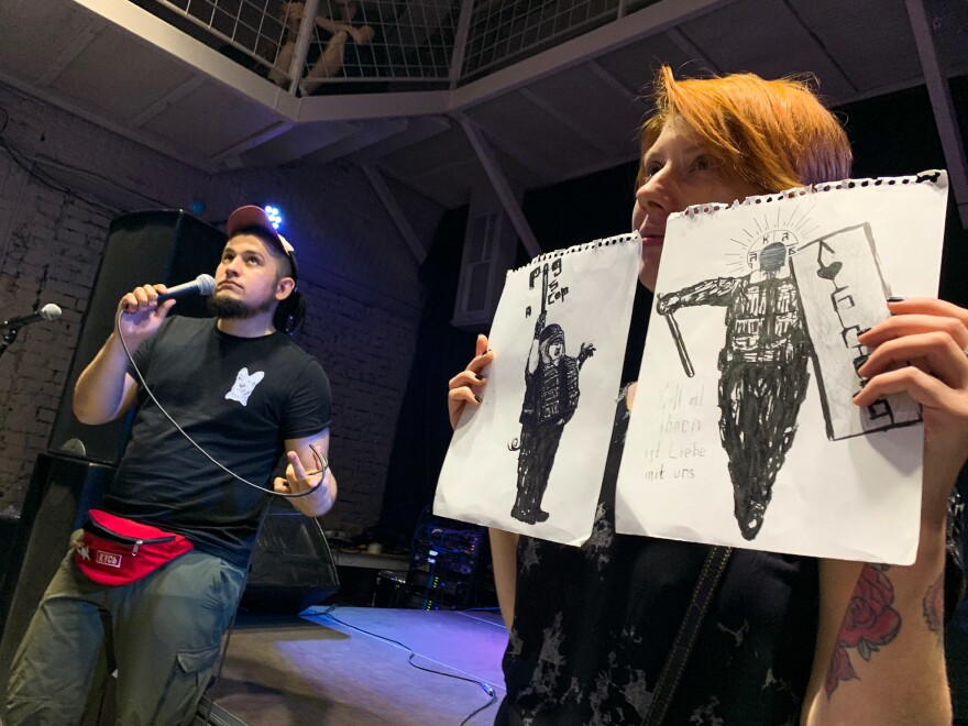 At an auction to support political prisoners in Moscow, two drawings of riot policemen go on the block. They were drawn by Oleg Navalny, the younger brother of opposition leader Alexei Navalny, who spent more than three years in prison after a conviction he calls politically motivated.