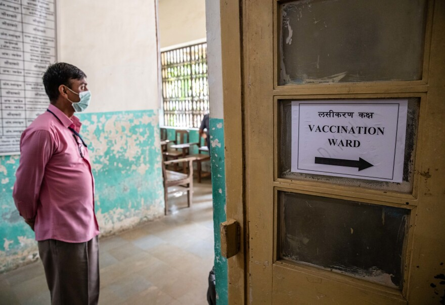 A man stands outside the vaccination ward.