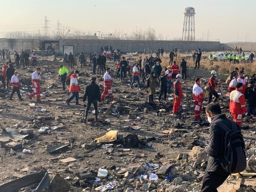Search and rescue workers at the crash site of a Ukrainian Boeing 737 outside Tehran, Iran. The plane crashed just after takeoff, killing all 176 aboard.