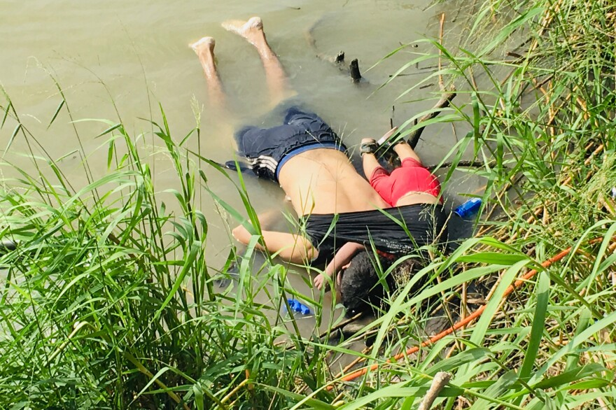 The bodies of Óscar Alberto Martínez Ramírez and his nearly 2-year-old daughter, Valeria, lie on the bank of the Rio Grande in Matamoros, Mexico, where they were found Monday morning. They drowned while trying to cross the river to Brownsville, Texas. This photograph was first published in the Mexican newspaper <em>La Jornada</em>.