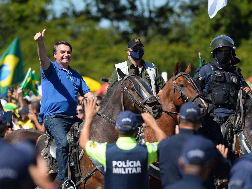 Brazilian President Jair Bolsonaro horse-riding during a demonstration in favor of his government amid the coronavirus pandemic in front of Planalto Palace on May 31, in Brasilia.