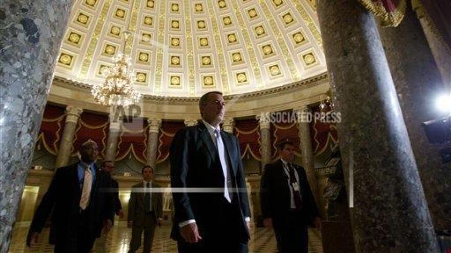 House Speaker John Boehner walks to the House floor on Saturday.