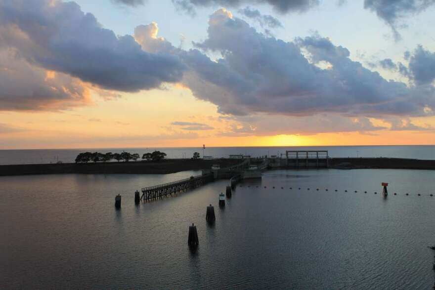 The sun sets behind the lock and dam on Lake Okeechobee and St. Lucie Canal.