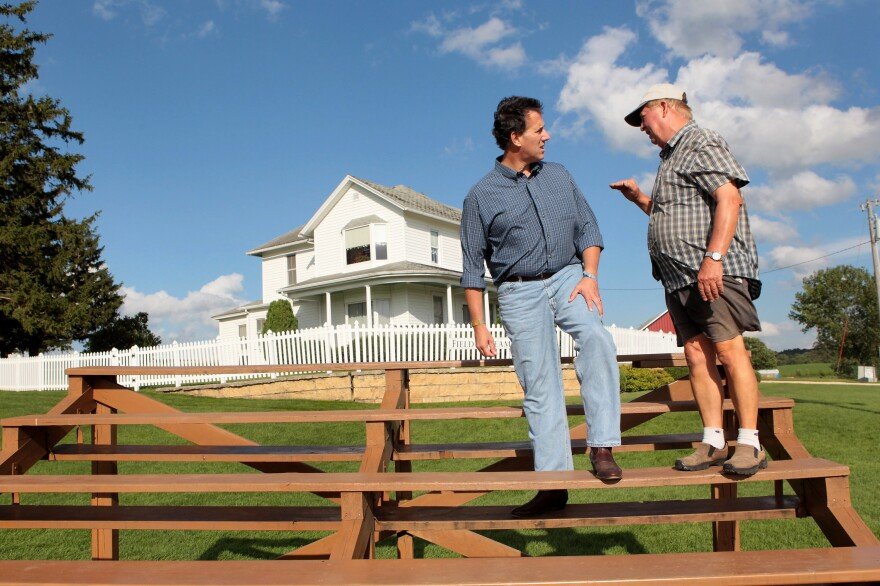 In 2011, then-presidential hopeful Rick Santorum chats with Don Lansing, whose family farm in Dyersville, Iowa, served as the site of <em>Field of Dreams.</em>