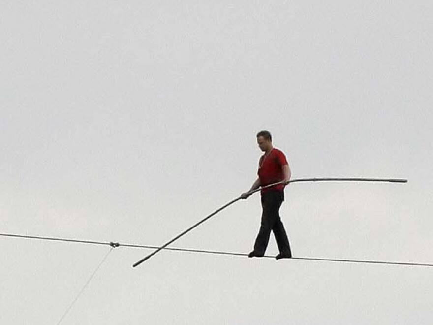 With no net below, Nik Wallenda walks a 1,000-foot-long high wire, suspended 200 feet over the Allegheny River in downtown Pittsburgh in 2009.