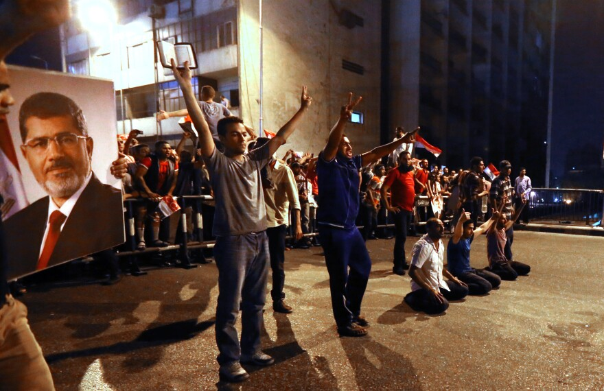 Supporters of the Muslim Brotherhood and Egypt's ousted President Mohamed Morsi block the Six October bridge on Tuesday in the center of Cairo.