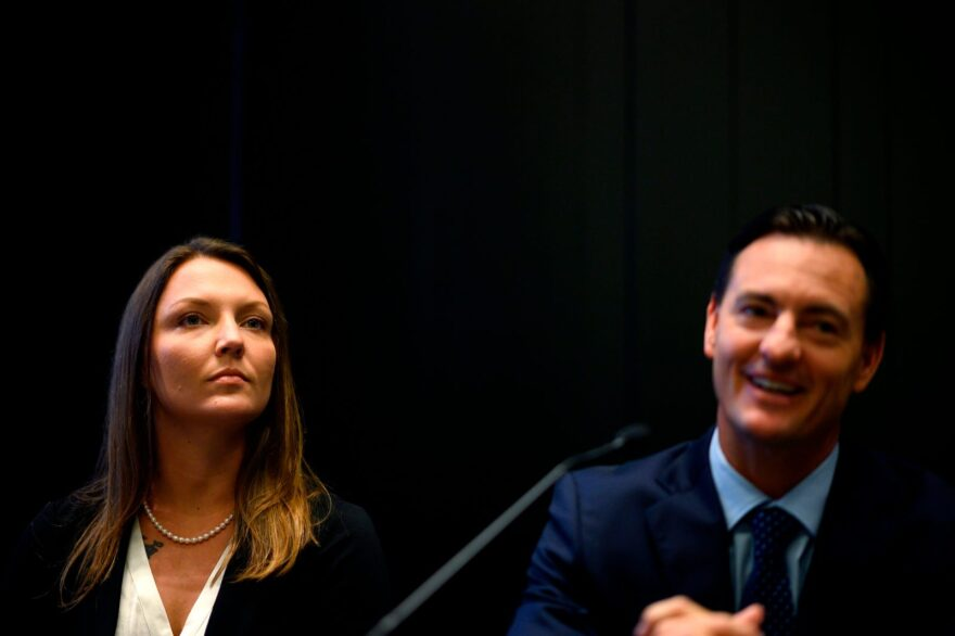 Courtney Wild (L), who claims she was abused by Jeffrey Epstein when she was a minor, and her lawyer Brad Edwards attend a news conference in New York City.
