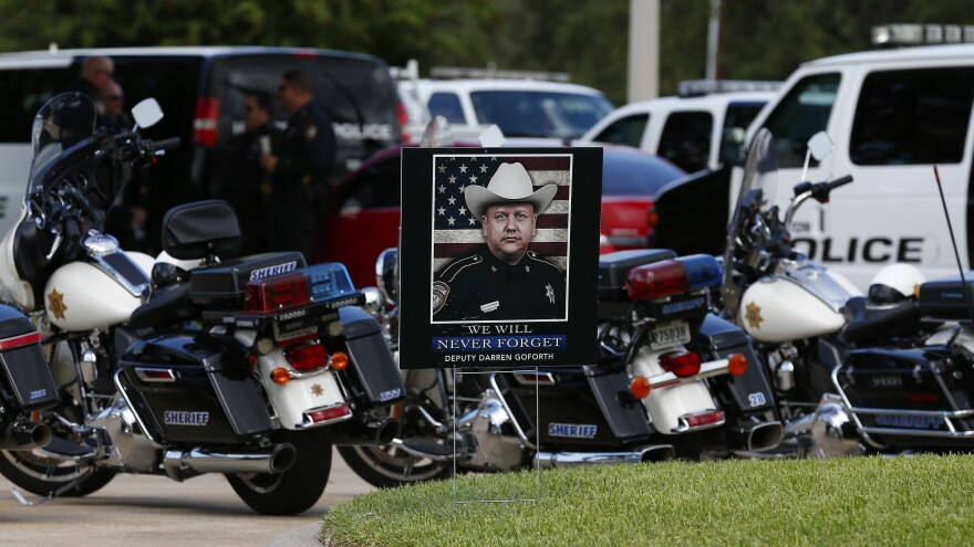 A photo of Darren Goforth is seen near his funeral Friday at Second Baptist Church in Houston, Texas. Deputy Darren Goforth was fatally shot at a gas station last week.