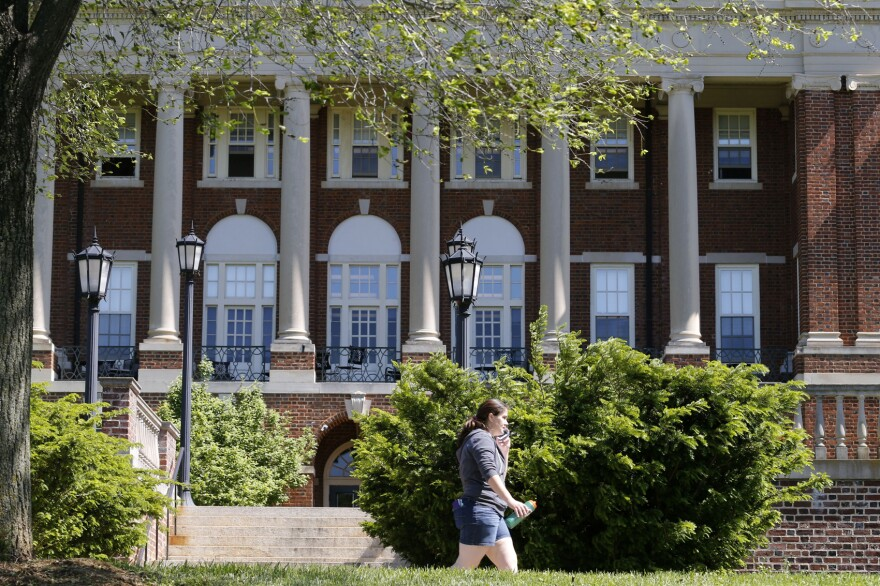 In this photo taken on Wednesday, May 13, 2015, a Sweet Briar College student walks past a building at the school in Sweet Briar, Va. The school nearly closed in 2015 amid financial difficulties. (Steve Helber/AP)