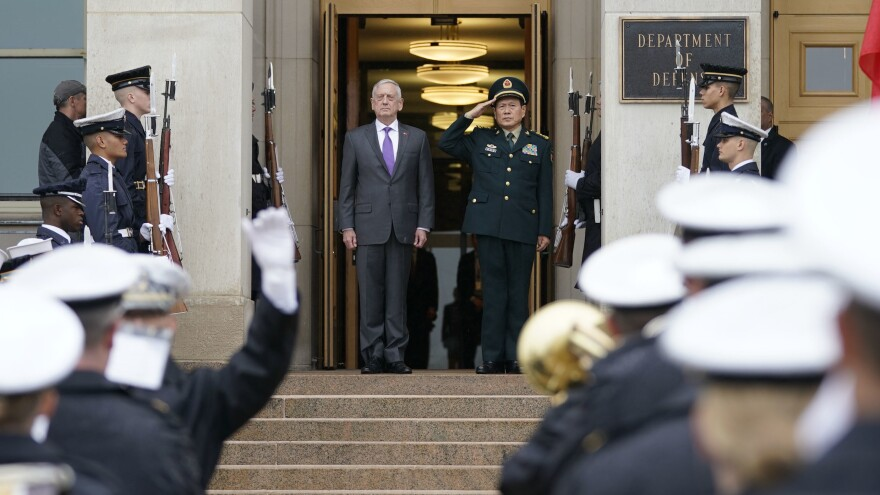 Defense Secretary Jim Mattis and China's Defense Minister Gen. Wei Fenghe stand as the national anthems are played before their meeting at the Pentagon on Friday.
