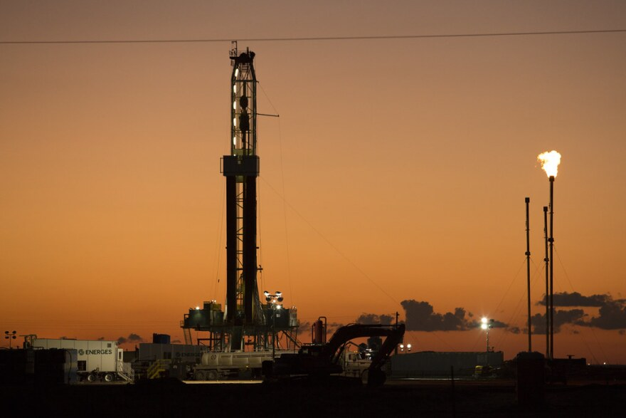 An oil rig and gas flares in far West Texas