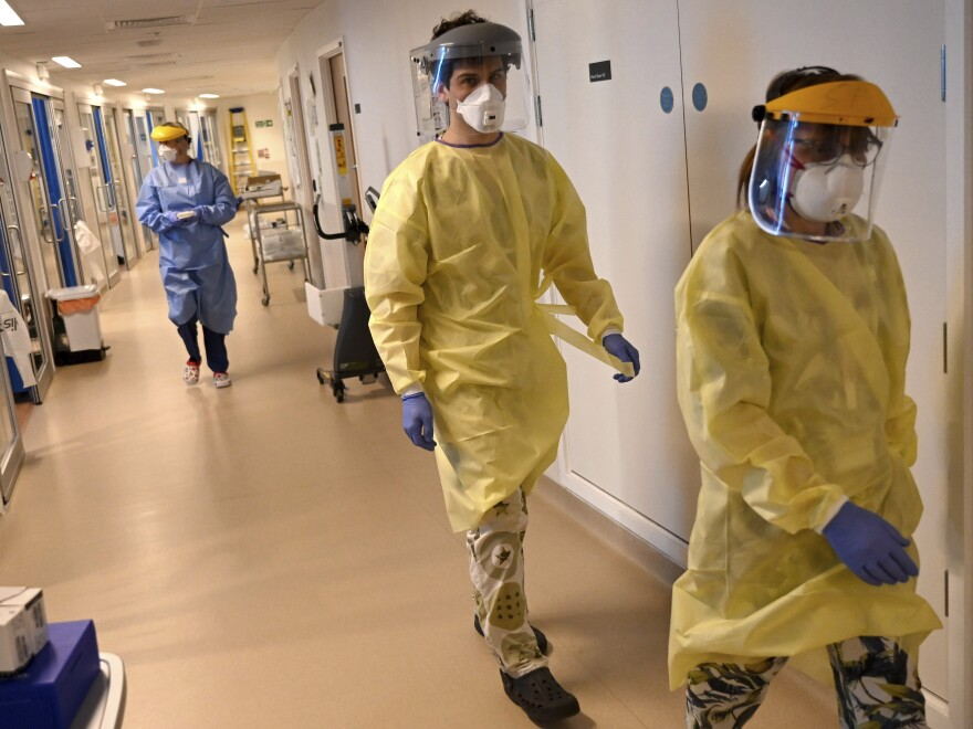 Coronavirus deaths in the U.K. have passed those in Italy. Workers in the intensive care unit at the Royal Papworth Hospital in Cambridge are shown gearing up to care for COVID-19 patients.
