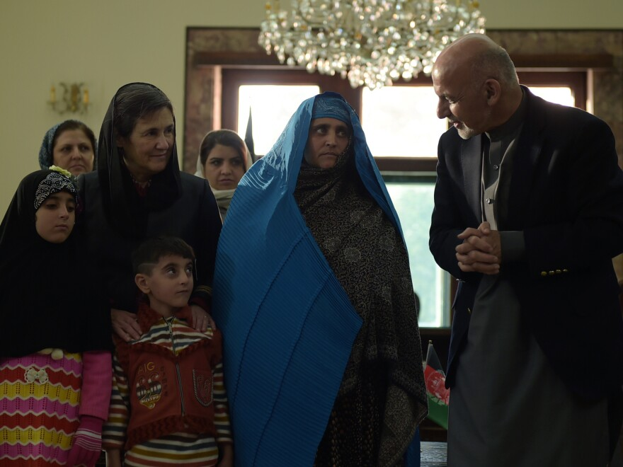Afghan President Ashraf Ghani with Sharbat Gula (center) at the Presidential Palace in Kabul on Wednesday.