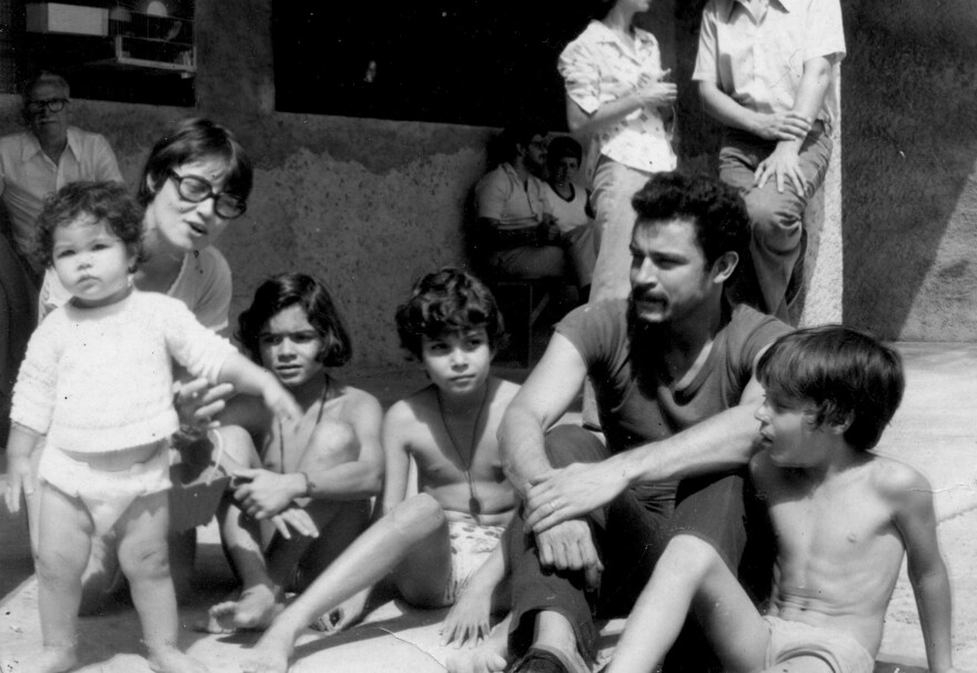 Maria Amelia Teles (left) sits with her husband Cesar Teles and their two children in Sao Paulo in the 1970s. She was tortured; her children were brought in to see her after she was beaten. She is calling for the amnesty law, which protects those responsible, to be revoked.