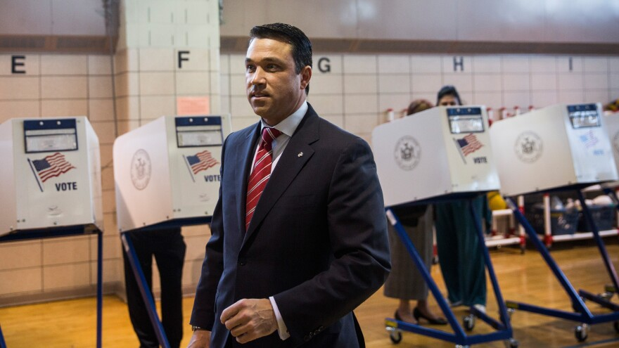 Rep. Michael Grimm, seen here after voting in the Staten Island borough of New York City, was indicted on 20 criminal counts earlier this year.
