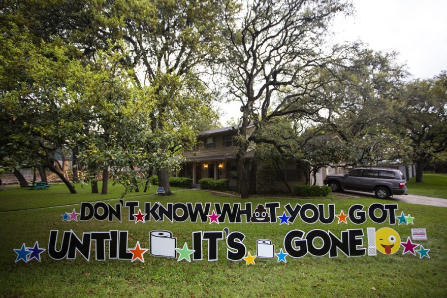 A yard sign referencing toilet paper shortages in the Northwest Hills neighborhood of Austin during the coronavirus pandemic on March 20, 2020.