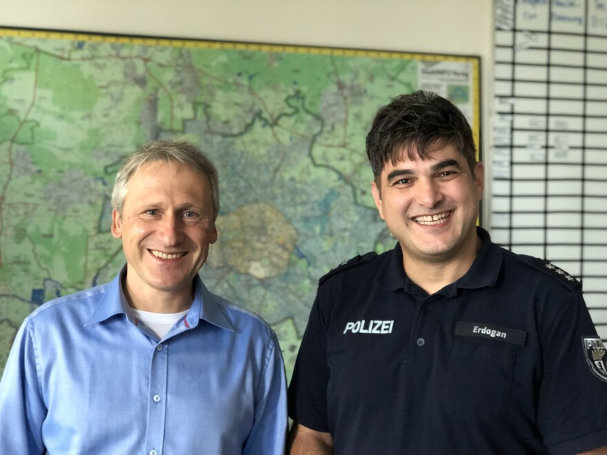 Officers Eckhardt Lazai (left) and Ersin Erdogan help teach behavioral content to cadets at the Berlin Police Academy. The two invite recently arrived refugees from Syria, Iraq and Afghanistan to help train their cadets.