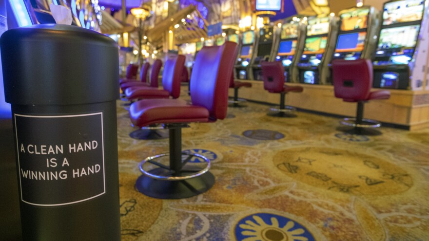 A hand sanitizing wipe station is seen next to the slot machines at the Mohegan Sun casino on May 21. Connecticut's two federally recognized tribes said they're planning to reopen parts of their casinos on June 1, despite Gov. Ned Lamont saying it's too early and dangerous.